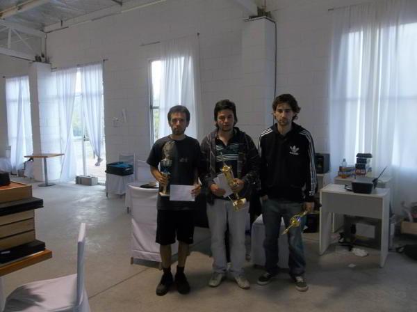 Premiados del IRT A: Perera (centro), Lares (izq) y Toniutti (der)