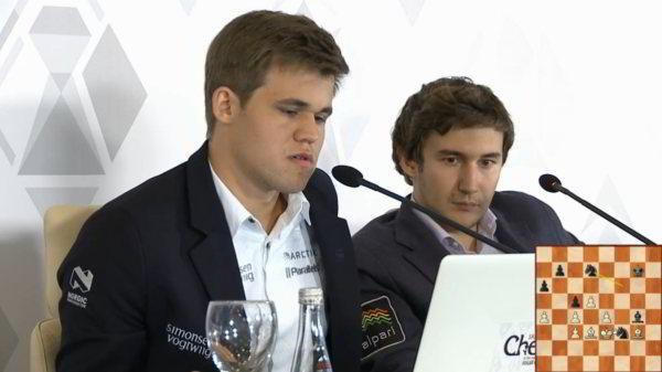 Magnus Carlsen y Karjakin comentando su luchado empate de la 3ra ronda